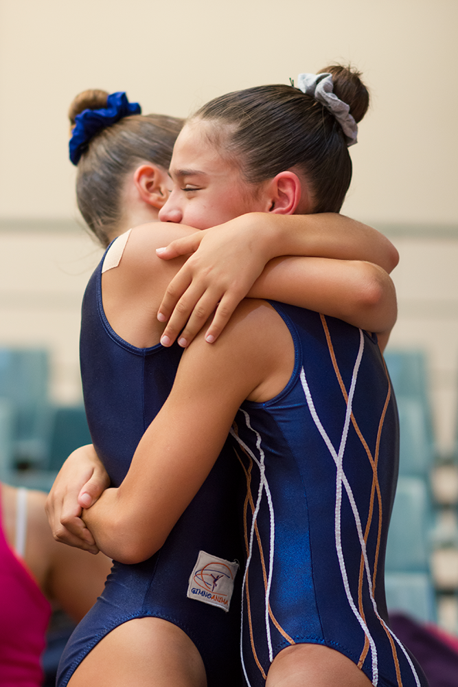 Gymnasts hugging each other